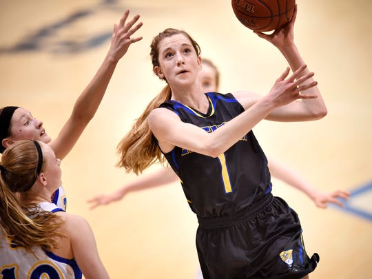 Cathedral's Kate Tomczik puts up a shot during the first half of Tuesday's East Sub-Section 6-2A playoff game against Rush City at St. John's University in Collegeville.
