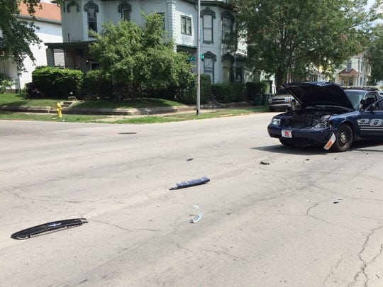 Debris was spread about 15 feet in front of a Richmond Police Department vehicle involved in an accident Thursday afternoon.
