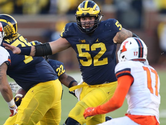 Michigan's Mason Cole blocks Illinois' Stanley Green during the fourth quarter of U-M's 41-8 win at Michigan Stadium.
