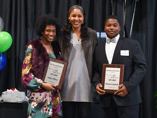 WNBA player Maya Moore stands with Southside High senior Ashley Oliver, left, and junior Brinton Gambrell after they were presented with The Greenville News Coaches 4 Character Awards during Coaches 4 Character at The Salvation Army Kroc Center in Greenville on Tuesday, December 6, 2018.
