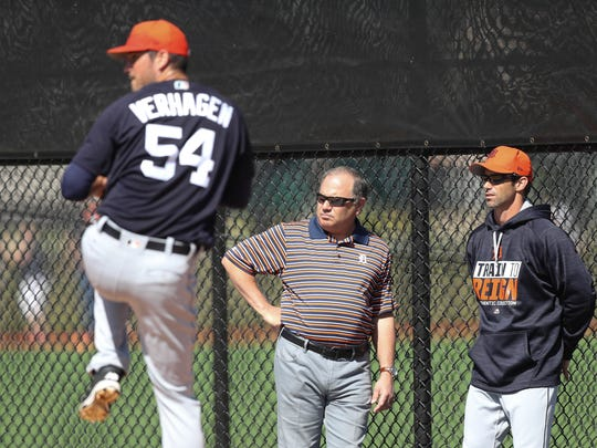 Detroit Tigers general manager Al Avila, center, and manager Brad Ausmus, right, talk as Drew VerHagen pitches during spring training Friday, Feb. 17, 2017, in Lakeland, Fla.