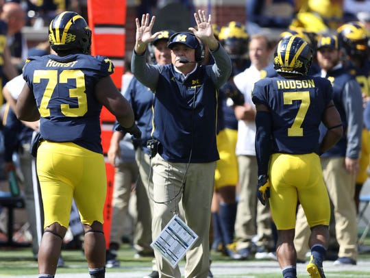 Michigan defensive coordinator Don Brown congratulates