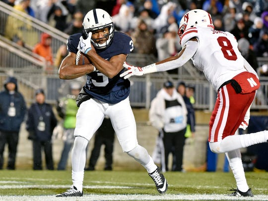Penn State's DeAndre Thompkins catches an end zone reception for a touchdown against Nebraska in the first half of an NCAA Division I football game Saturday, Nov. 18, 2017, at Beaver Stadium. Penn State defeated Nebraska 56-44 in its final home game of the 2017 season.