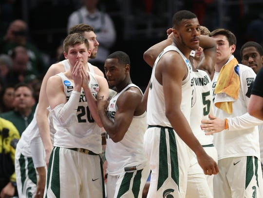 Michigan State's Matt McQuaid, left, and Xavier Tillman react to a 55-53 loss to Syracuse in the 2018 NCAA tournament at Little Caesars Arena in Detroit.