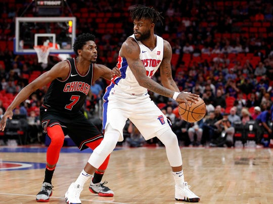 Mar 24, 2018; Detroit, MI, USA; Detroit Pistons wing Reggie Bullock is defended by Chicago Bulls guard Justin Holiday during the first quarter at Little Caesars Arena.