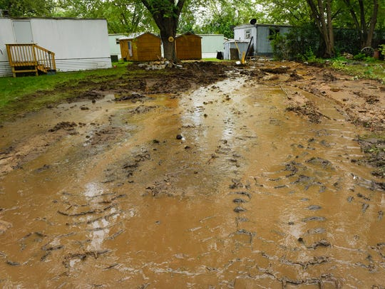 Mud and water remained after a mobile home over a broken