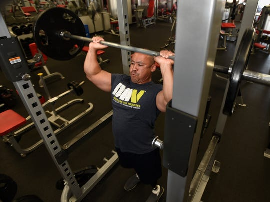 Bobby Body, 44, of St. Johns works out Wednesday, July
