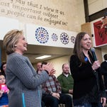 Chelsea Clinton (right) will campaign for her mother Hillary Clinton (left) on Saturday