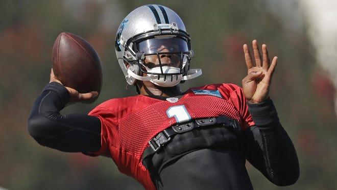 Cam Newton looks to pass during a Carolina Panthers practice last summer.