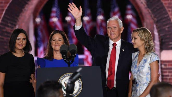 Audrey Pence, Second Lady Karen Pence, US Vice President Mike Pence and Charlotte Pence Bond stand on stage at the end of the third night of the Republican National Convention at Fort McHenry National Monument in Baltimore, Maryland on Aug. 26 2020.