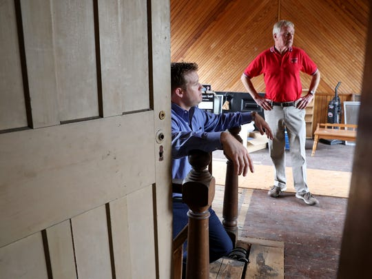 Bryan White, Fairport village manager, and Fritz May, Fairport village mayor, in the attic of the The Potter House in Fairport.