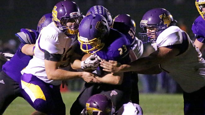 Sheboygan Falls' Simon Bifano (23) carries the ball against Two Rivers on Friday.