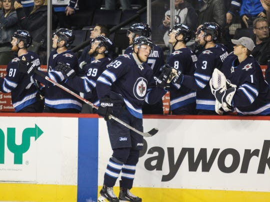 Jets forward Patrik Laine (29) is congratulated on