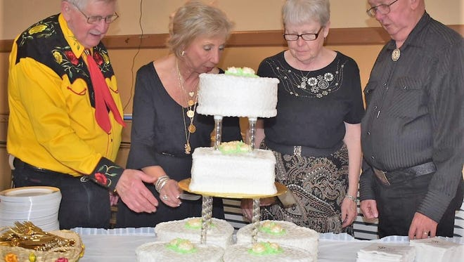 50th anniversary Ron and Norma Faust, married in May 1968, and Joe and Pat Rennie, tying the knot January 1968, shared their celebration at a 50th wedding anniversary party at Germania Mannerchor. The good friends are pictured here cutting their cake.