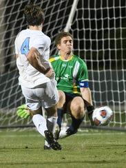 Palmer Trinity goalkeeper Matias Acosts stops a shot