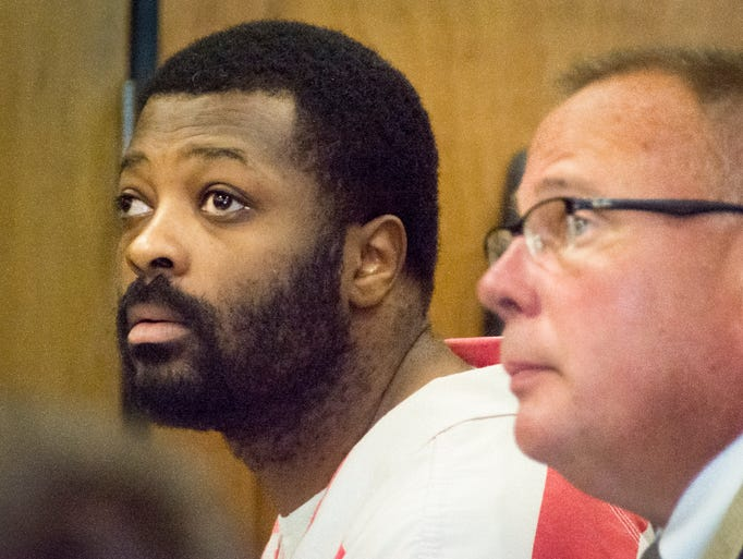 Rashaune Ramsey sits with his attorney Josh Brown. He was sentenced to 25 years to life in prison Friday morning, Aug 22, 2014, for rape and kidnapping.