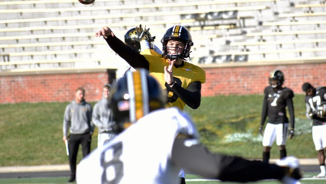 Missouri quarterback Connor Bazelak (8) throws a pass to a teammate during an October 2019 practice at Faurot Field