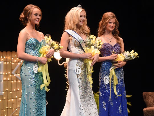 First runner-up Tiana Vincent, (from left) Baxter County Fair Princess Zoe Cimino and second runner-up Alayna Rhode are recognized on stage during Saturday night's pageant.