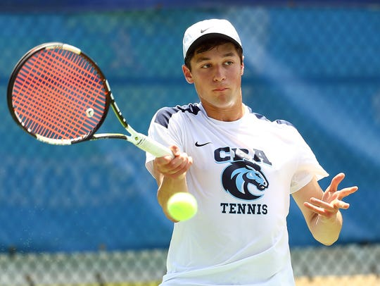 CBA's second singles Matthew Jaworski returns a forehand