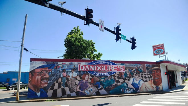 The side of Dandgure's is painted with a colorful mural.