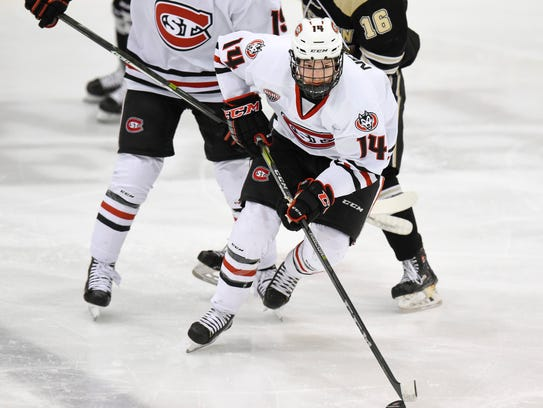 St. Cloud State's Patrick Newell skates withe the puck