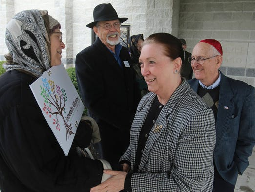 Phyllis and Harold Singer, right, members of Temple Israel, thank Jessie and Carl Haworth,  of the Interfaith Alliance of the Ozarks, for  showeing support at the Temple Israel's Passover Seder dinner.