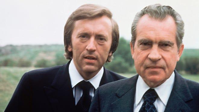 Broadcaster David Frost poses with former President Richard Nixon in California in  1977.