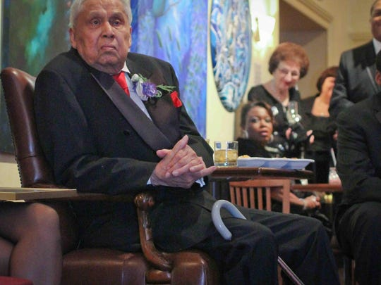 Jim Gilliam Sr. listens as people pay tribute to him in December 2010 at The Grand Gala, the Grand's biggest fundraiser.