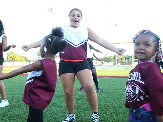 The American Youth Football Red Bank Buccaneers cheer squad practice at Count Basie Field in Red Bank.