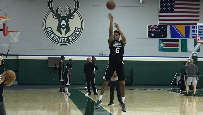 Axel Toupane works out with the Bucks.