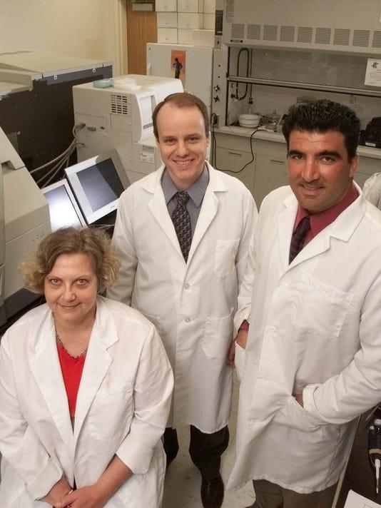 Tatiana Seregina, Dr. Charles Link, and Dr. Nick Vahanian of NewLink Genetics Corp. of Ames