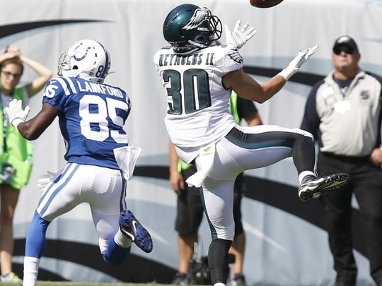Eagles safety Ed Reynolds tips and collects a pass intended for Colts receiver Ryan Lankford in the fourth quarter Sunday.