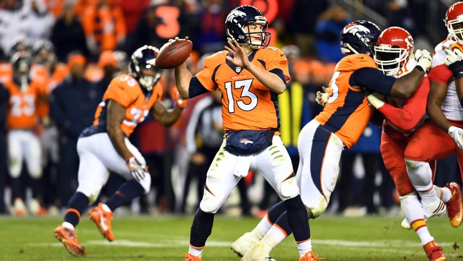 Denver Broncos quarterback Trevor Siemian (13) prepares to pass in a overtime period against the Kansas City Chiefs at Sports Authority Field at Mile High.