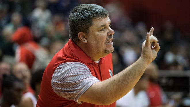 Evansville Bosse boys' basketball coach Shane Burkhart was a defensive starter on Marion's last regional championship team in 1990. The Giants travel to Evansville Central for the Class 4A Semi-State on Saturday afternoon.