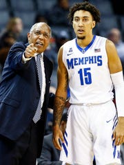 Memphis head coach Tubby Smith (left) chats with David Nickelberry (right) during action against UConn at the FedExForum in Memphis Tenn., Tuesday, January 16, 2018.