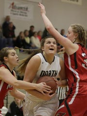 Grace Garvey of Appleton North drives between Lexi