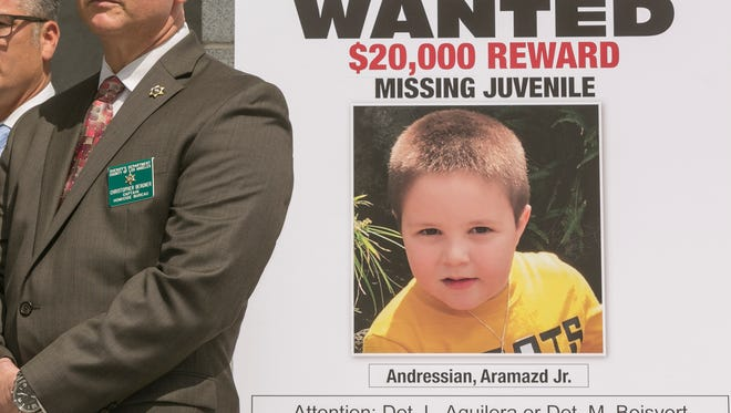 During a May 17 news conference, Los Angeles County Sheriff's Department Capt. Christopher Bergner stands by a poster of Aramazd Andressian Jr., a 5-year-old boy who has been missing for several weeks from South Pasadena.