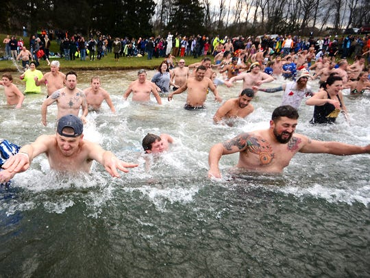 Almost 400 people plunged into the frigid water at