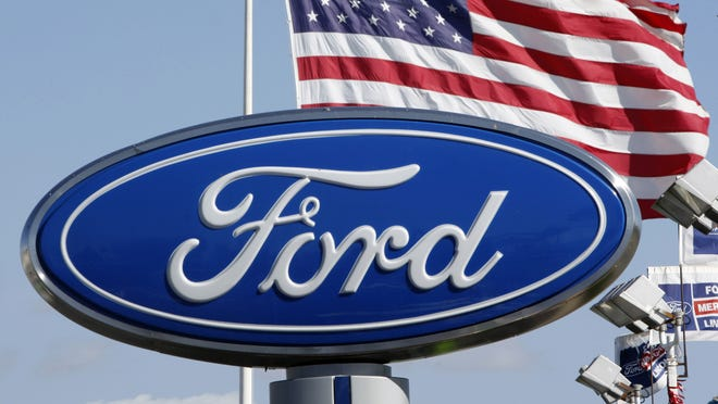 In this Oct. 25, 2010 photo, the Ford logo is displayed.