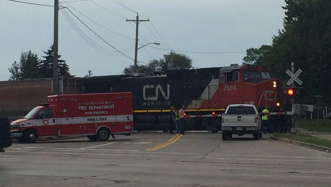 A Canadian National train is stopped across Chase Street, near the Riverview Expressway in Wisconsin Rapids Wednesday after it hit a teenage boy crossing the tracks.
