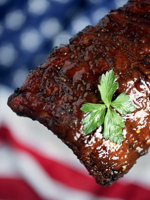 Baby back ribs are a favorite for holiday weekend barbeques. Friday June 24, 2005 J. KYLE KEENER/Detroit Free Press