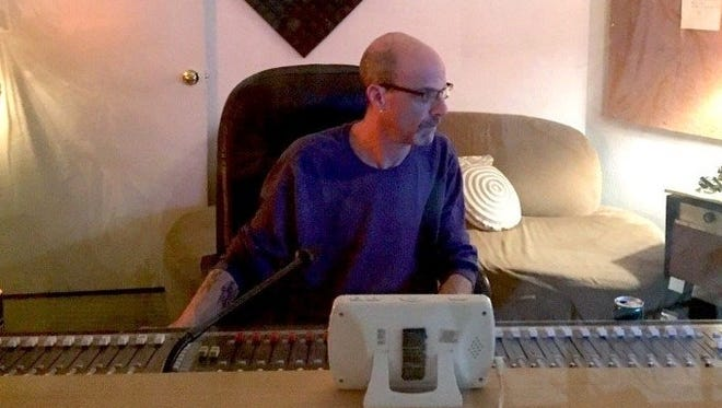 Film composer Howard Wulkan works on some recordings at his studio.