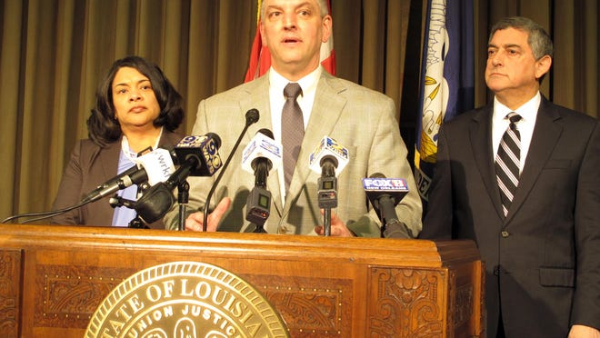 Louisiana Gov. John Bel Edwards, center, unveils his proposals for balancing Louisiana's budget, including a list of tax increases for legislative consideration, during a news conference, Jan. 19. Joining Edwards are Revenue Secretary Kimberly Robinson, left, and Commissioner of Administration Jay Dardenne.