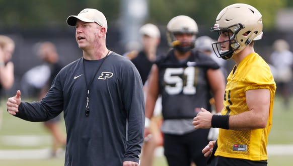 Head coach Jeff Brohm with instructions during Purdue