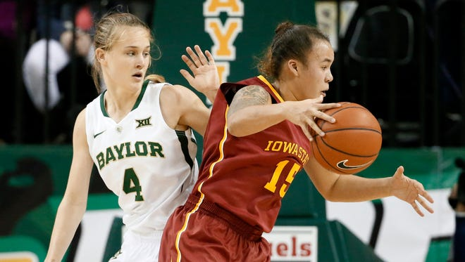 Baylor's Kristy Wallace (4) defends as Iowa State guard Kidd Blaskowsky looks for an opportunity to the basket in the second half of Tuesday's game in Waco, Texas. Blaskowsky had 20 points, but the Cyclones lost 79-47 to the third-ranked Bears.