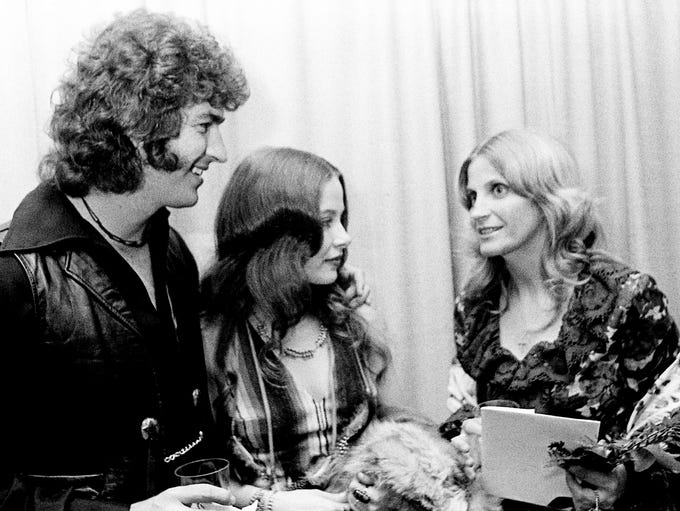 Mac Davis, left, his wife, Sarah, and Skeeter Davis