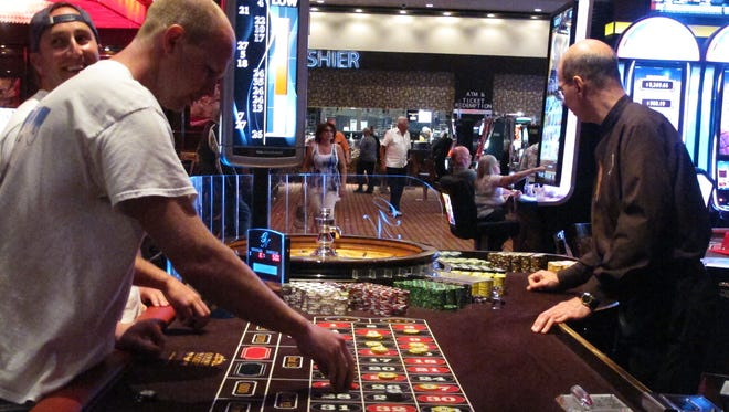 Gamblers play a game of roulette at the Golden Nugget casino in Atlantic City.
