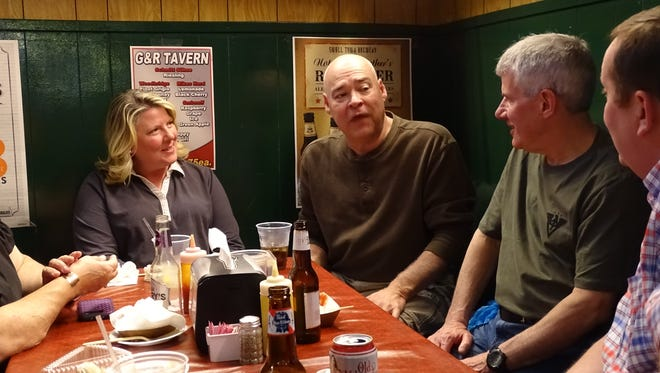 Several Sunbury, Ohio, residents talk and laugh over beers at the G&R Tavern Saturday. It was the first time at the restaurant for Angel Beller, left; Rob Beller, center, and Roger Rickman, right.