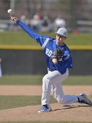 Salem senior pitcher Eric Scott fires the baseball toward home plate Friday afternoon.