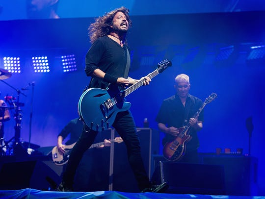 Dave Grohl  and Pat Smear of Foo Fighters perform on